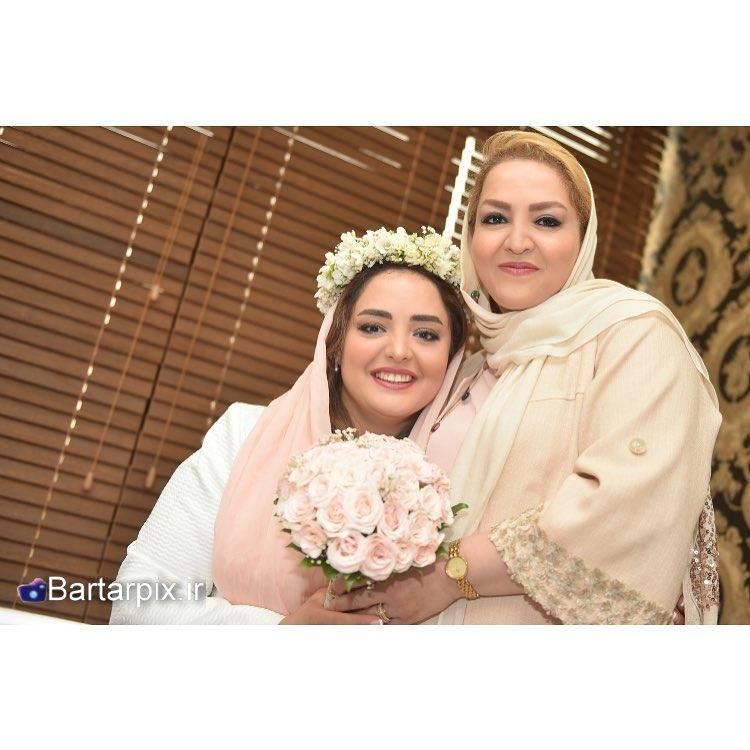 http://s9.picofile.com/file/8295390684/www_bartarpix_ir_nargesmohamadi_va_hamsaras_ali_oji_1_.jpg